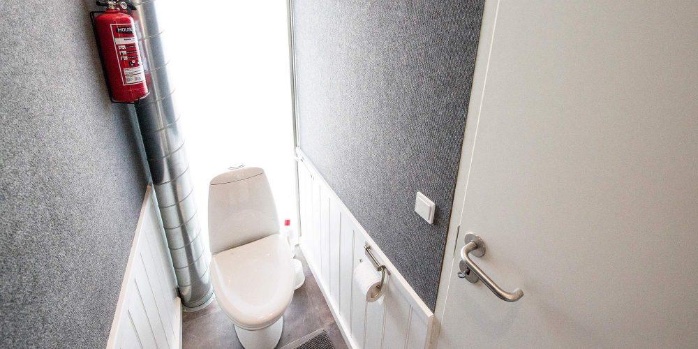Toiletfaciliteter i bagenden